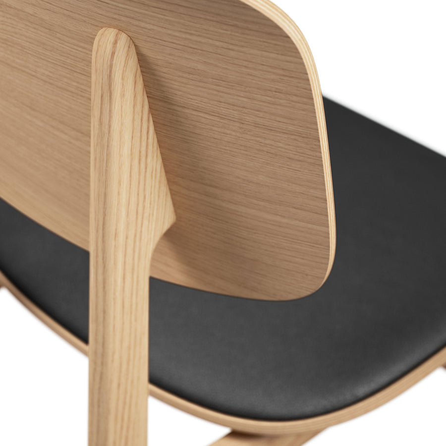 Norr11 Denmark, NY11 Dining Chair Natural Oak, Black Leather, detail | Spencer Interiors