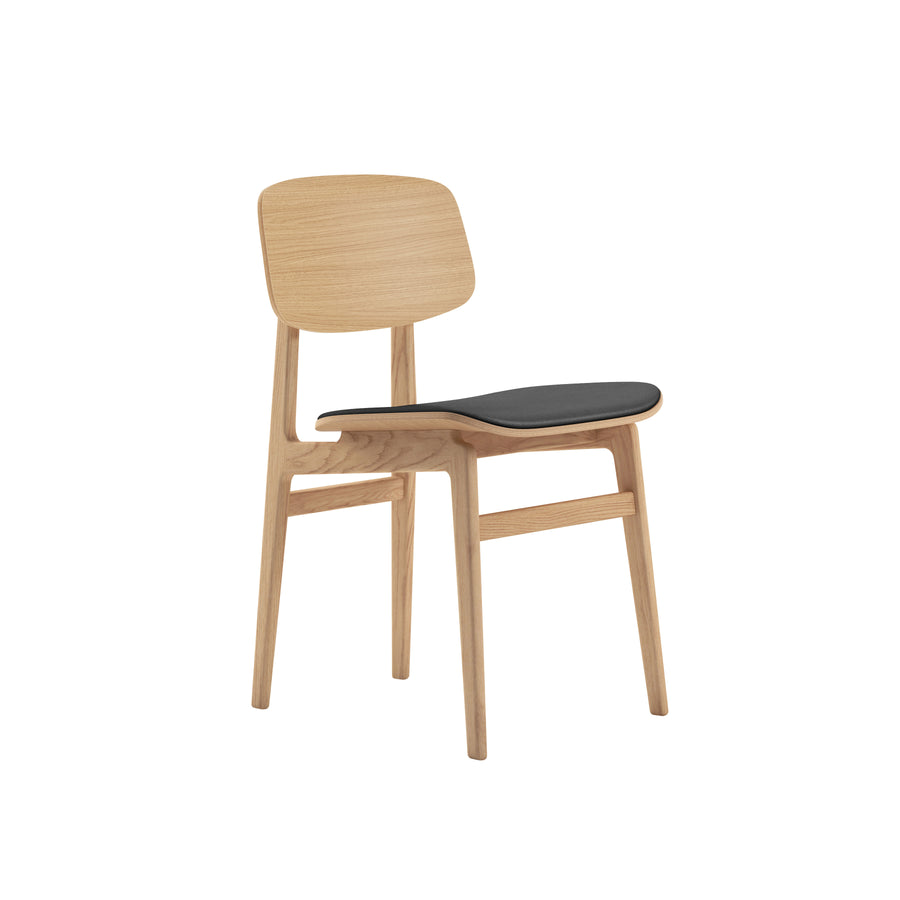 Norr11 Denmark, NY11 Dining Chair Natural Oak, Black Leather, front turned | Spencer Interiors