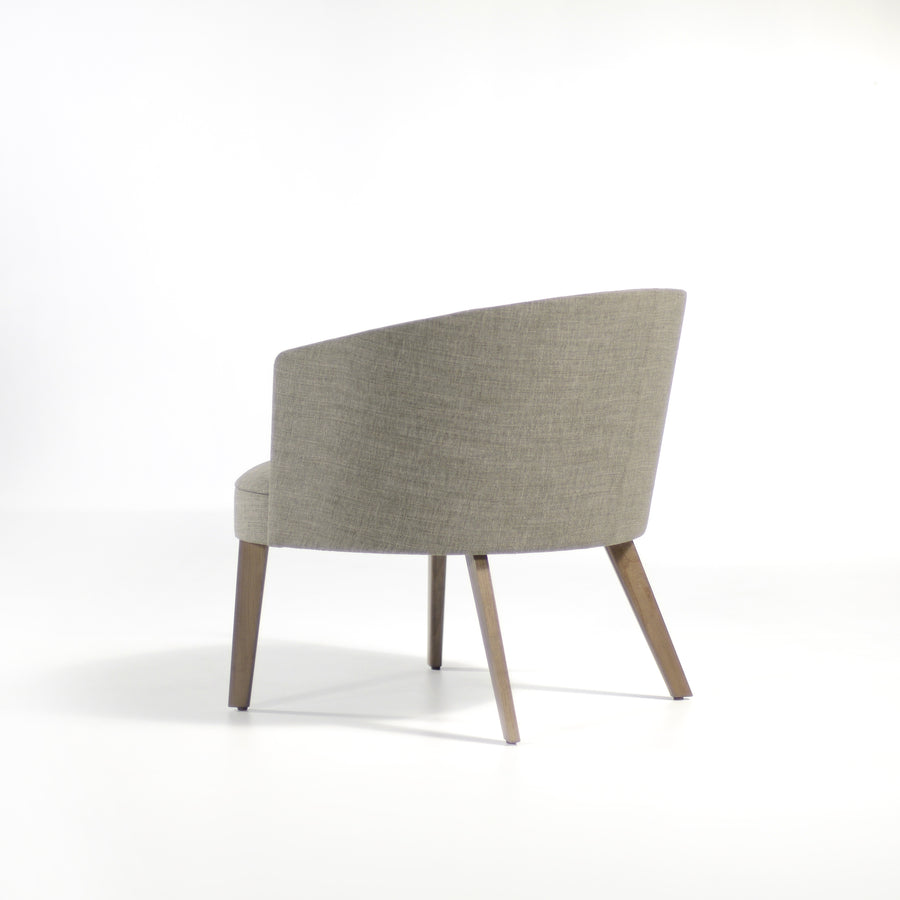 Potocco Lena Lounge Armchair in fabric Bold Grigio, back turned | © Spencer Interiors
