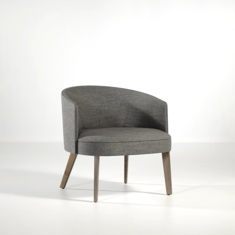Potocco Lena Lounge Armchair in fabric Bold Grigio Scuro, front turned | © Spencer Interiors