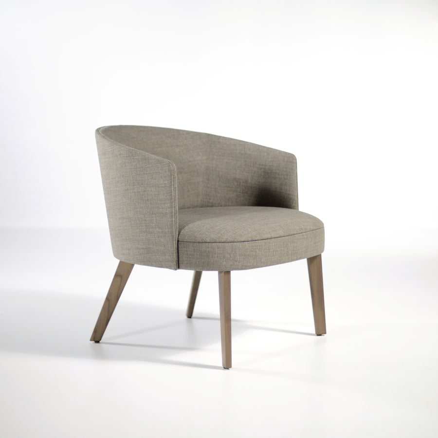 Potocco Lena Lounge Armchair in fabric Bold Grigio, profile turned | © Spencer Interiors