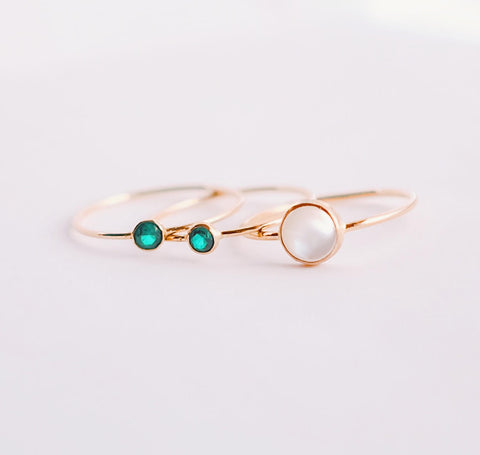 emerald and mother of pearl gold rings
