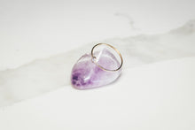 small ethical gold diamond ring on purple stone