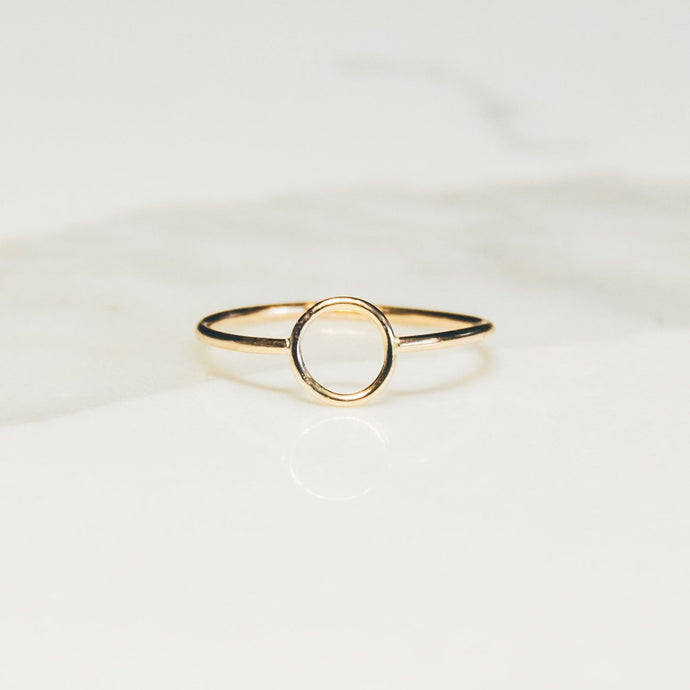 gold circle ring on white and light gray marble background