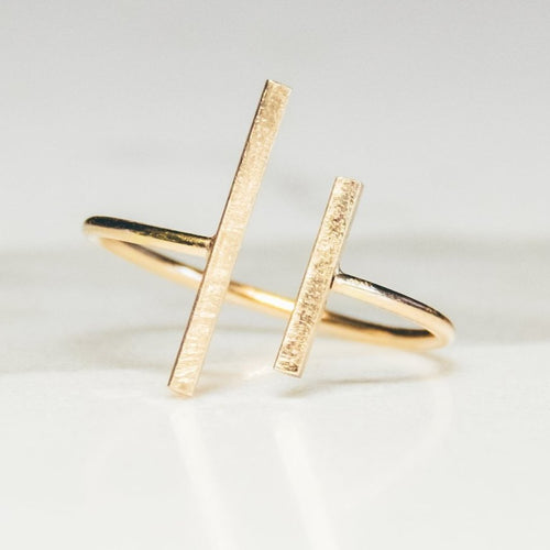 parallel bar gap ring in gold on white marble background