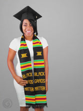 Load and play video in Gallery viewer, Black Grads Matter Kente Cloth Graduation Stole