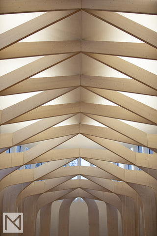 The pale wooden beams crisscross at the ceiling creating a light secondary structure © Nick Miners Photography