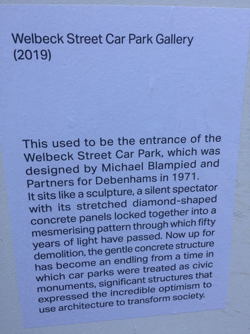 Sign announcing the gallery on hoardings at Welbeck Street Car Park in London