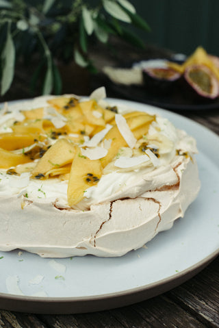 Pavlova with Crème Fraîche, Coconut and Tropical Fruits from Julia Busuttil Nishimura's 'Ostro'