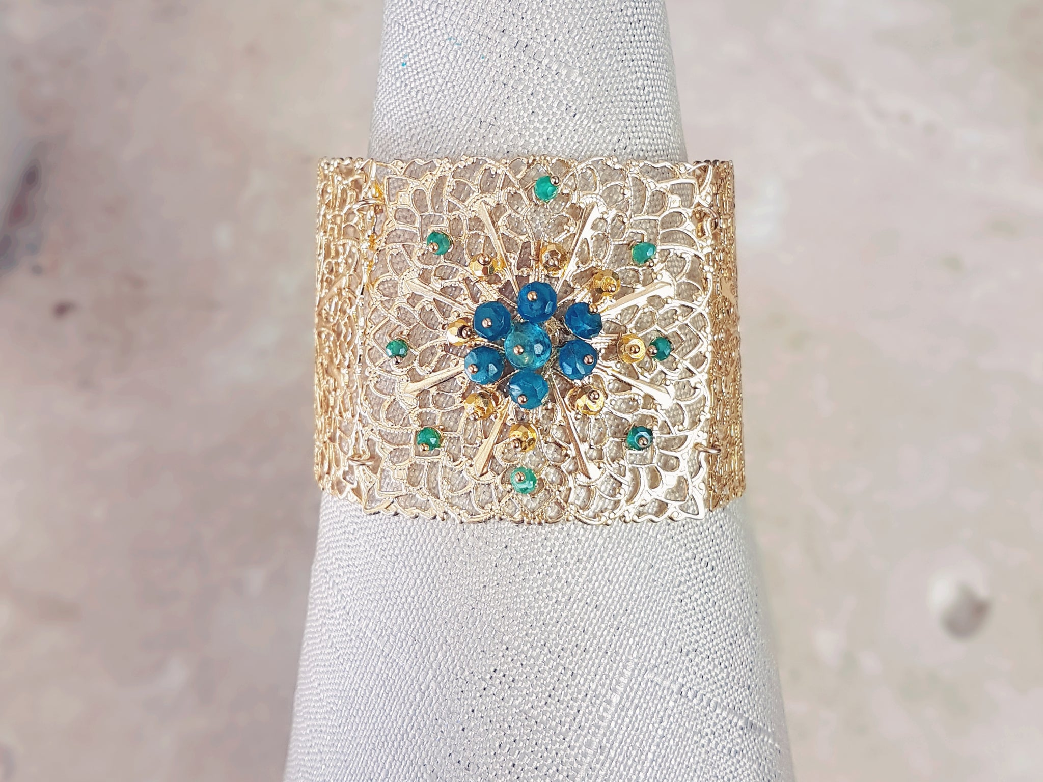 Gold Dipped Filigree Cuff Bracelet with Blue and Green Gemstones in flower pattern