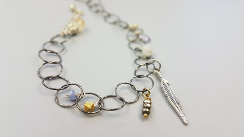 Enchanté Bracelet with semi-precious gemstones, 14K Gold filled and Sterling Silver baubles. Delicate, delightful and a best seller! Can be customized.
