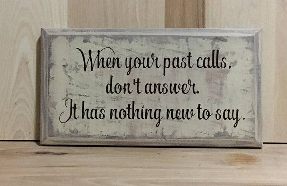 When your past calls, don't answer.  It has nothing new to say wood sign.