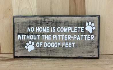 No home is complete without the pitter-patter of doggy feet wood sign.