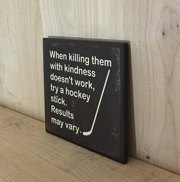 Funny wooden sign with hockey stick design.