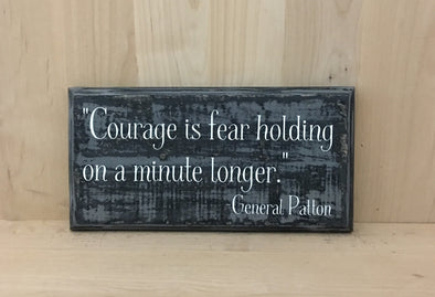 General Patton quote courage is fear holding on a minute longer.
