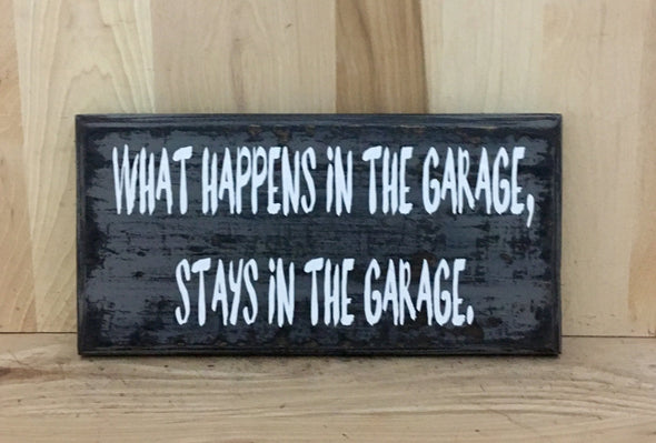 What happens in the garage stays in the garage wood sign.