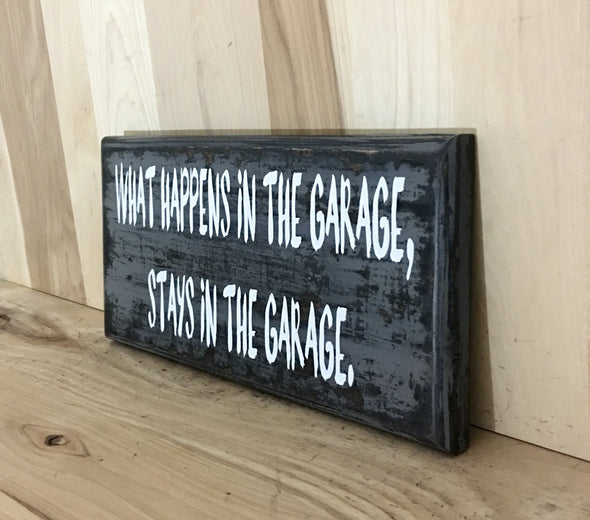 Garage wooden sign what happens in the garage.