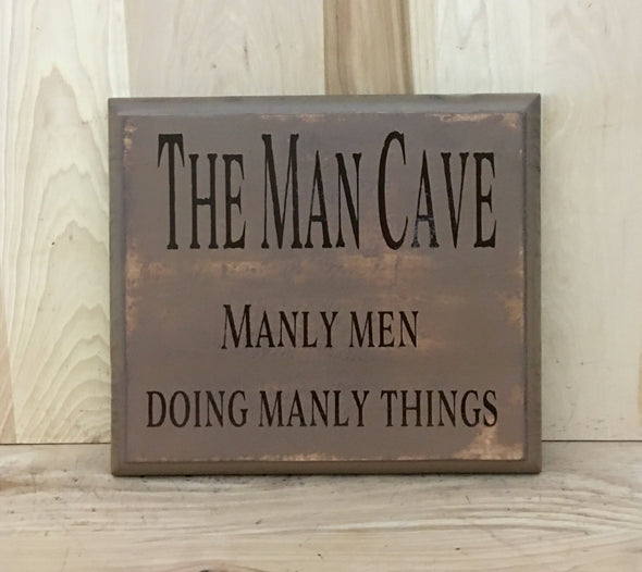 The man cave, manly men doing manly things funny wood sign.
