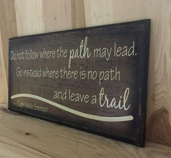 Ralhp Waldo Emerson quote on wood sign.
