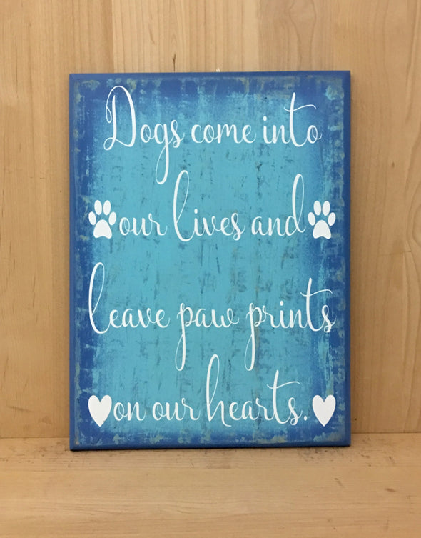Dogs come into out lives and leave paw prints on our hearts wood sign.