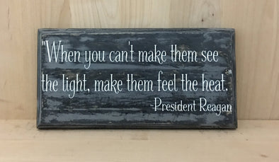President Reagan quote on wooden sign make them fell the heat.