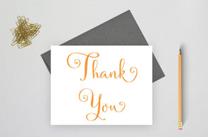 Folded wedding thank you card with gray envelope.