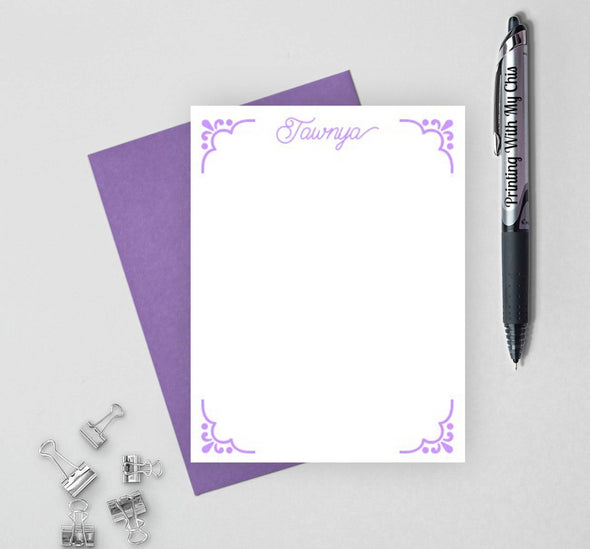 Decorative personalized stationery set with purple envelope.