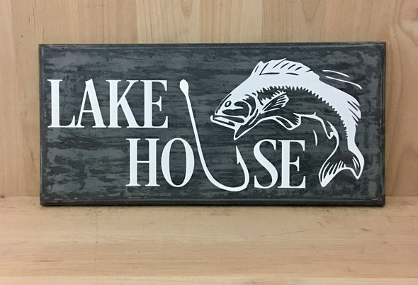 Lake house sign with fish design and hook wood sign.