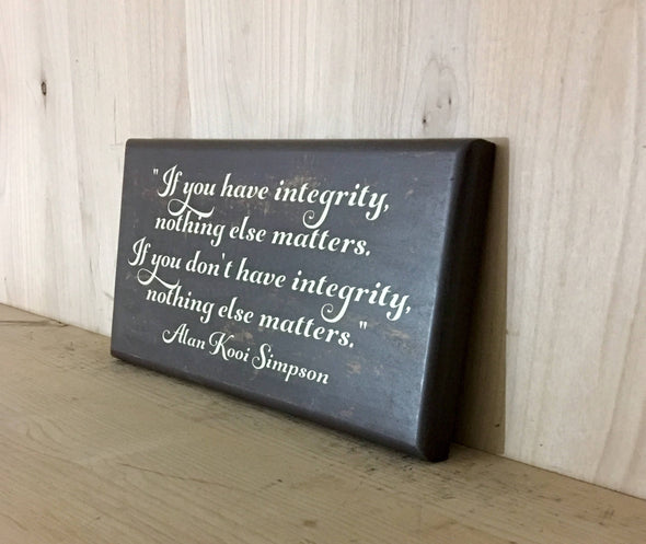 Custom wood sign with integrity quote.