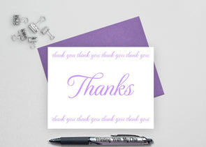 Folded wedding thank you card with purple envelope.