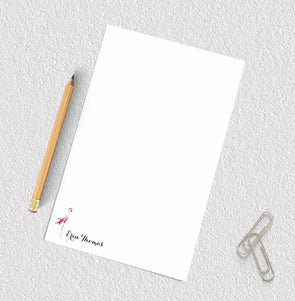 Personalized notepad with flamingo design.