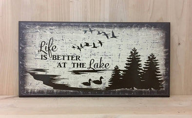 Life is better at the lake wood sign with tree and bird design.