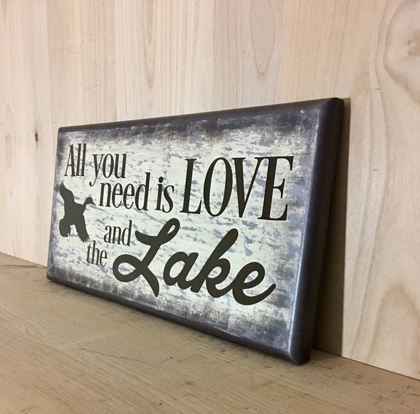 All you need is love and the lake wood sign for cabin decor or man cave.