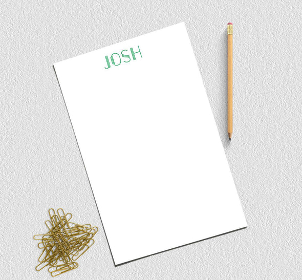 Personalized printed notepad in green ink.