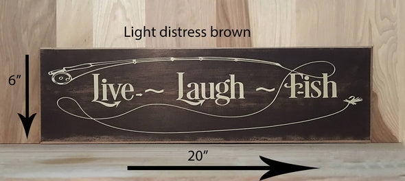 20x6 light distress brown with cream lettering live laugh fish fish fishing pole design.