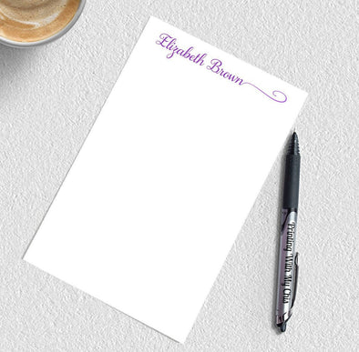 Women's personalized notepad with flourish.