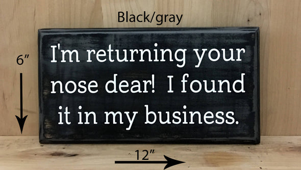 12x6 black/gray funny wood sign with white lettering.