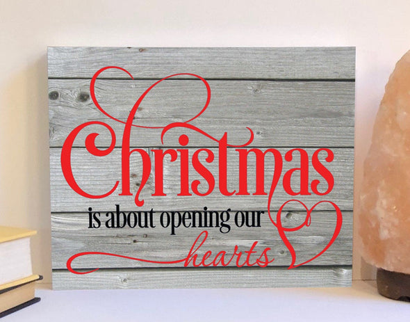 Christmas is about opening our hearts wood sign