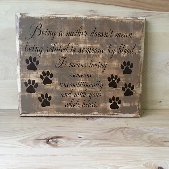 Being a mother wood sign for dog mom or dog dad.