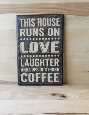 This house runs on love laughter and cups of strong coffee wood sign