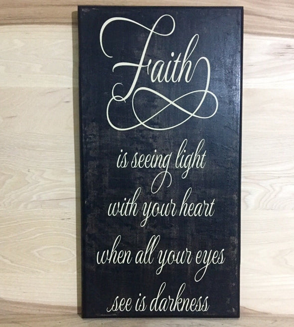 Faith is seeing light with your heart when all your eyes see is darkness sign.