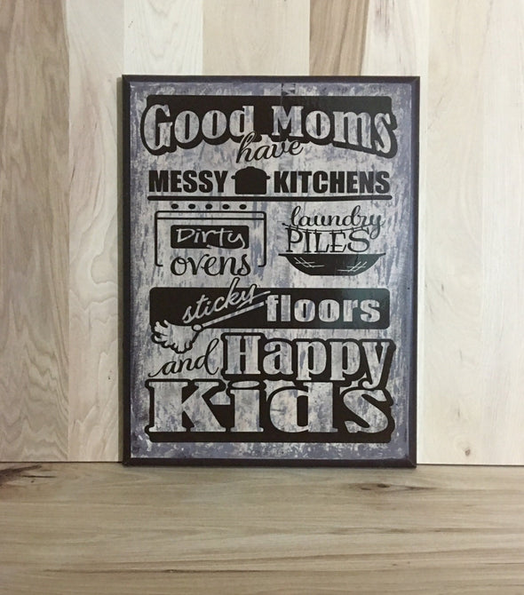 Good moms have messy kitchens, dirty ovens, laundry piles, sticky floors and happy kids sign.