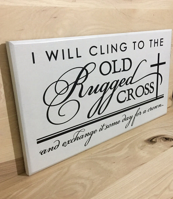 Old Rugged cross religious wooden sign with black lettering.