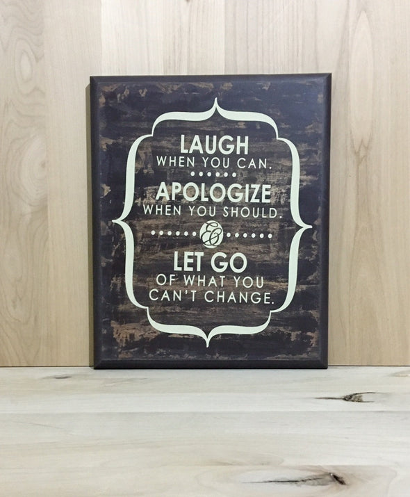 Laugh, apologize, let go custom wood sign.