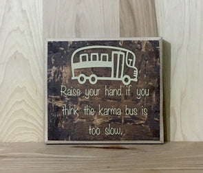 Raise your hand if you think the karma bus is too slow wood sign.