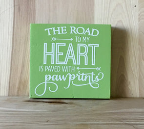 The road to my heart wood sign