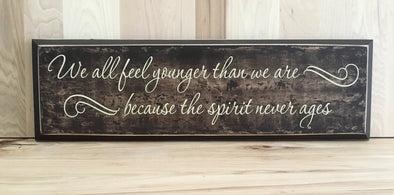 We all feel younger wood sign with saying