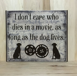 I don't care who dies in the movie as long as the dog lives wood sign.