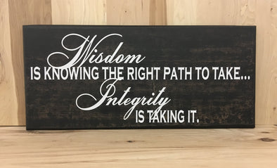 Wisdom wood sign with saying, integrity