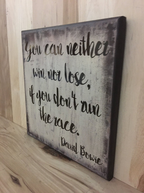 David Bowie quote on custom wooden sign.